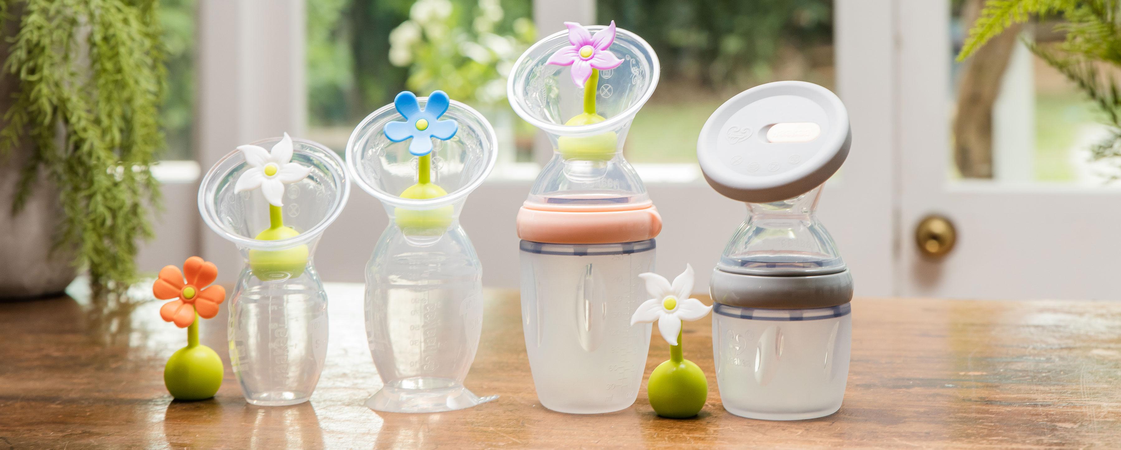Alle 3 Generationen der haakaa Pumpe mit allen gängigen Verschlüssen (Blumen und Deckel)